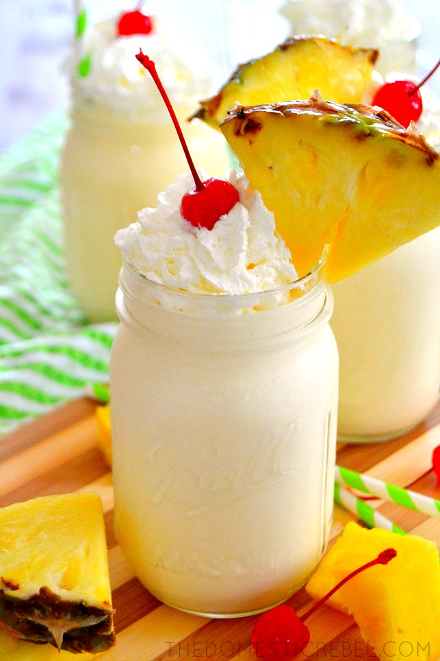homemade dole whips posed on wood board with fresh pineapple