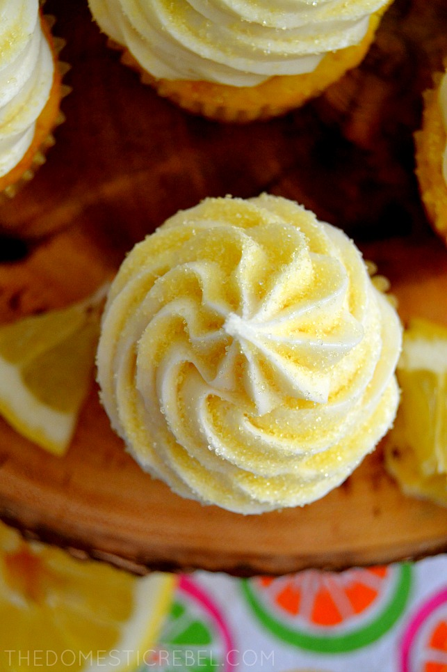 aerial view of a lemon bar cupcake on a wood board