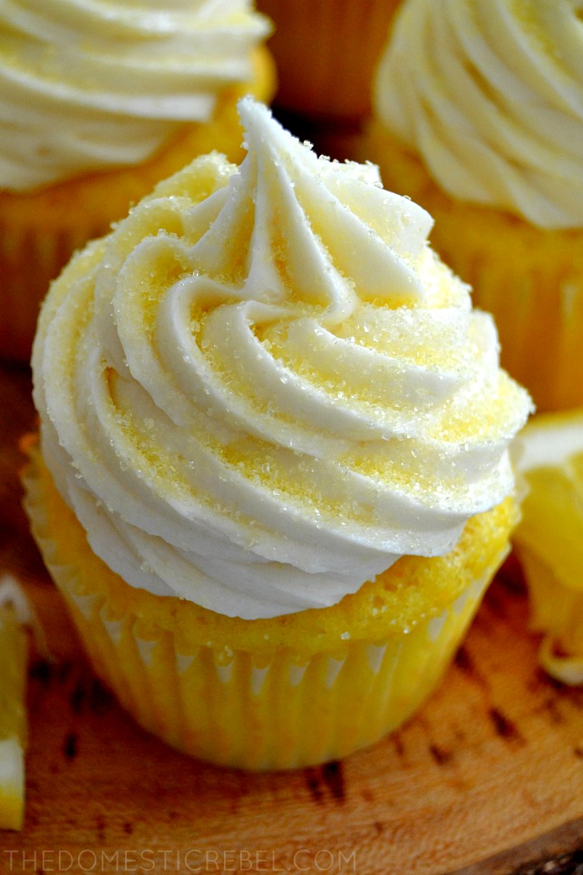 closeup photo of a lemon bar cupcake on a wood stand