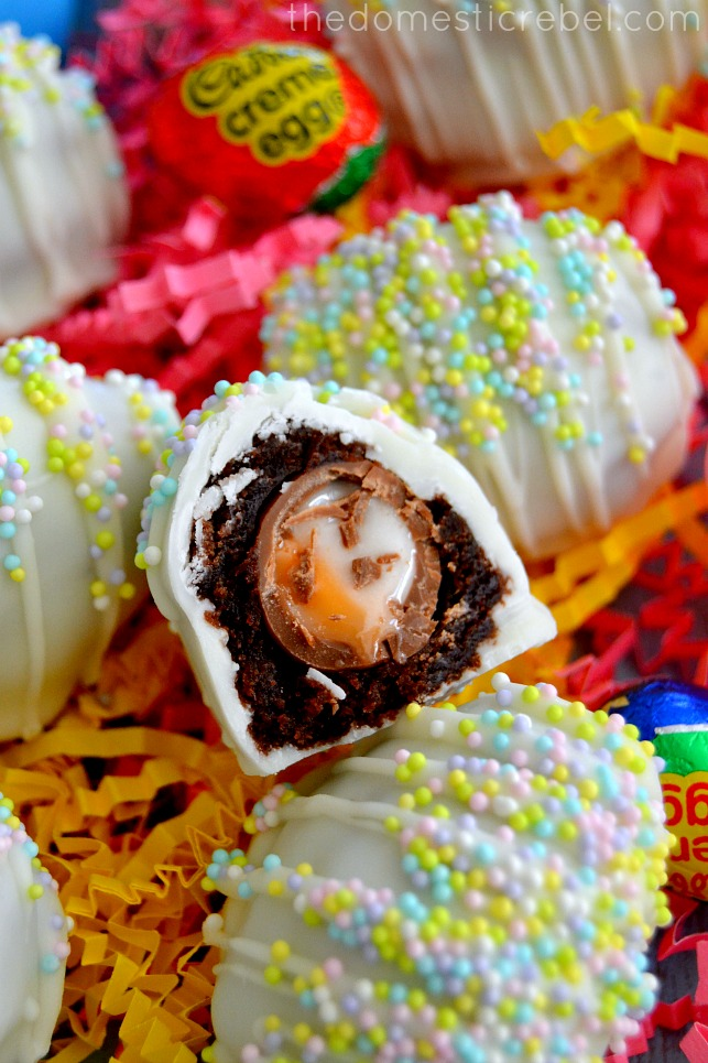 closeup photo of the inside of a cadbury creme egg brownie bomb arranged on paper shreds