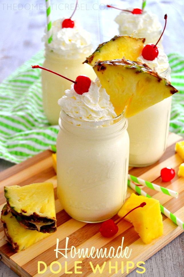 Homemade Dole Whips posted with fresh pineapple chunks on wood board