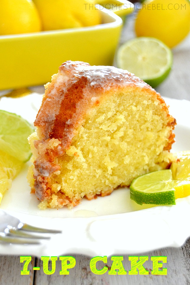 7Up Pound Cake on white plate with fresh citrus in background