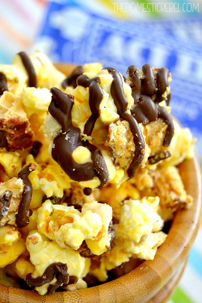 nutty buddy popcorn in a wooden bowl with popcorn package in background