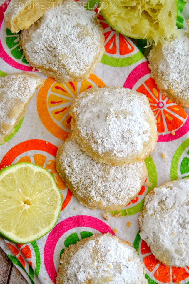 copycat lime cooler cookies arranged on citrus patterned fabric with fresh limes