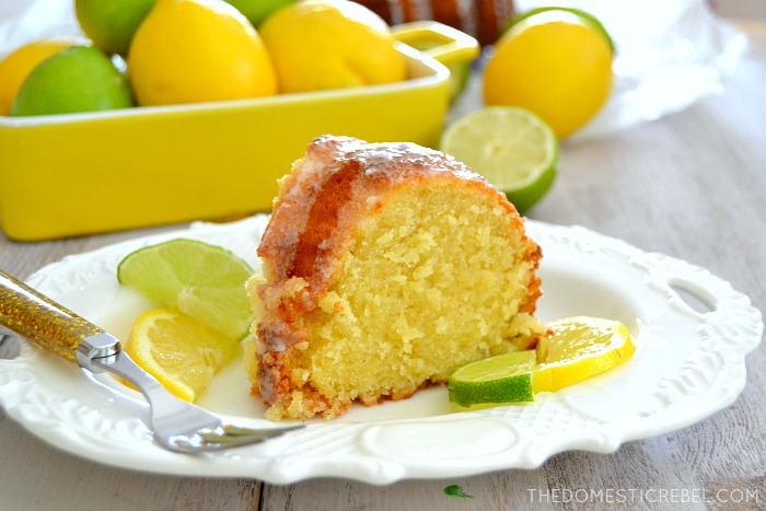 7Up Pound Cake on white plate with tons of fresh citrus in background
