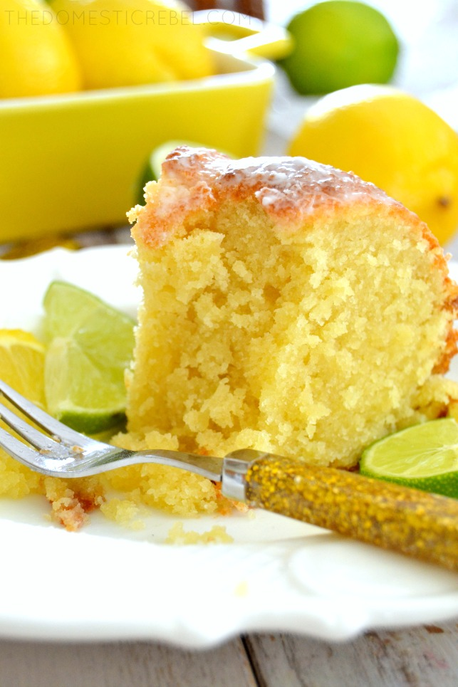 7Up Pound Cake on white plate with fork and fresh citrus slices