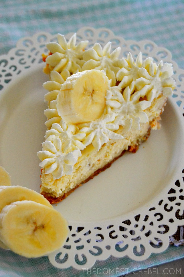 banana pudding cheesecake on white plate with fresh banana slices