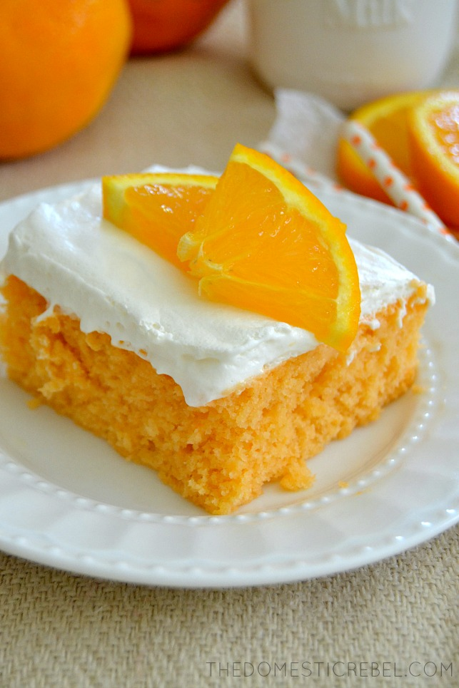 orange creamsicle cake on white plate and light tan background