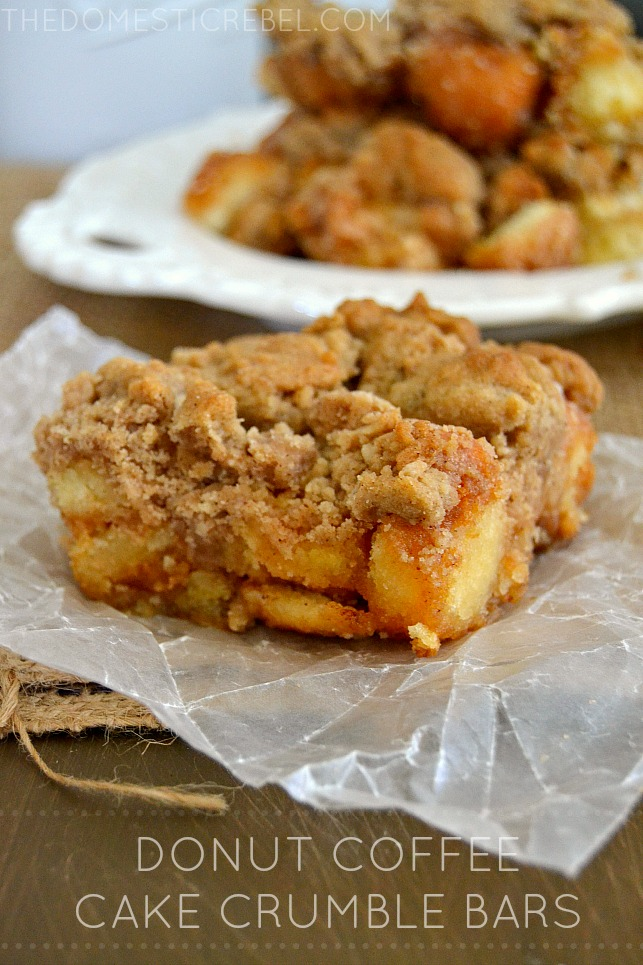 donut coffee cake crumble bars on a piece of parchment and wood