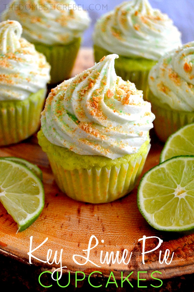 key lime pie cupcakes on wooden stand with lime slices