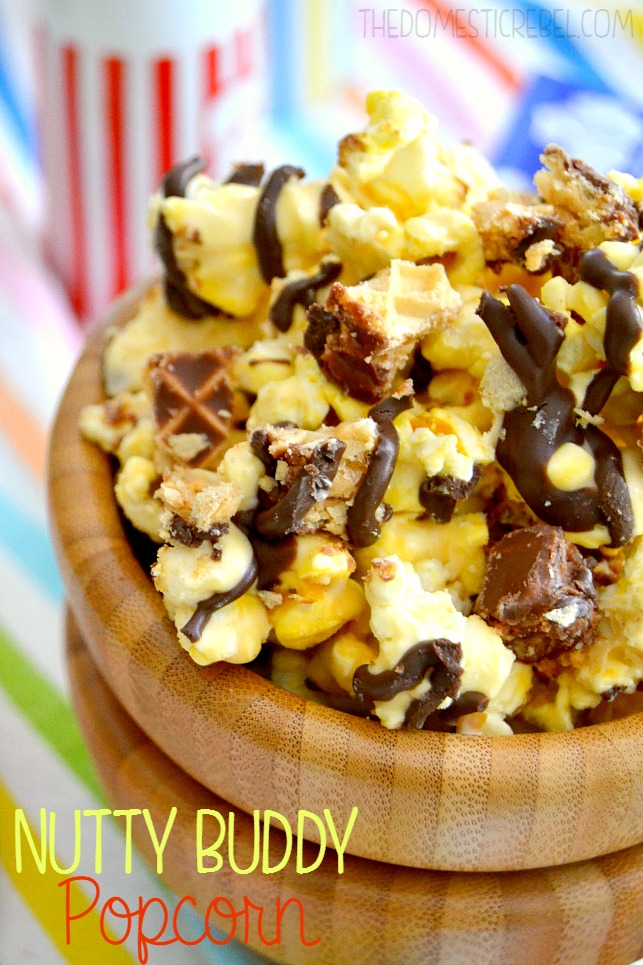 nutty buddy popcorn in a wooden bowl on rainbow background