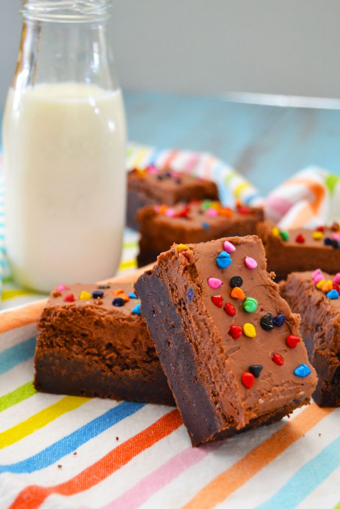 These Fudgy Frosted Brownies are the BEST, easiest, fudgiest brownies you'll ever have! Rich and chocolaty, they're like fudge with chocolate frosting on top!