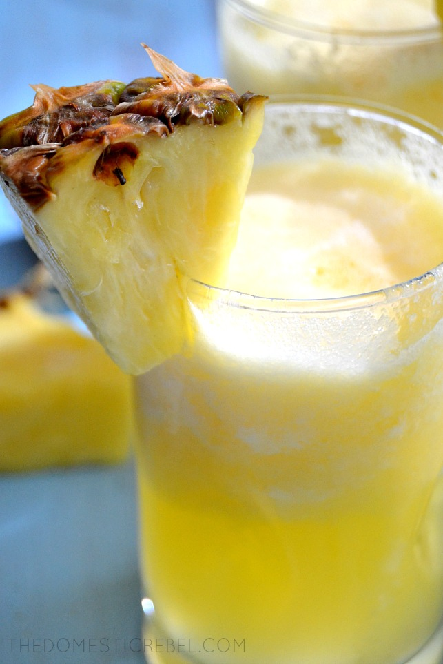 Pina Colada Bellinis in glass with a wedge of pineapple