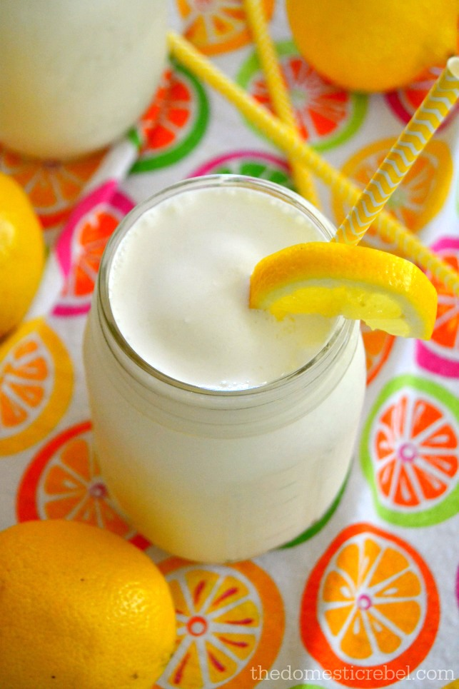 Frosted Lemonade in mason jar with lemons and yellow straws