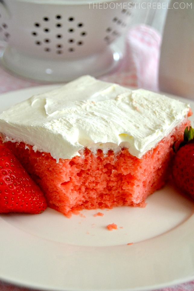 Strawberry and Cream Sheet Cake with bite missing on white plate
