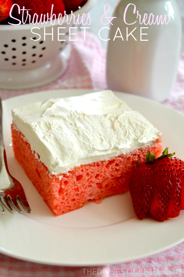 Strawberry and Cream Sheet Cake on white plate with sliced strawberry and pink gingham fabric