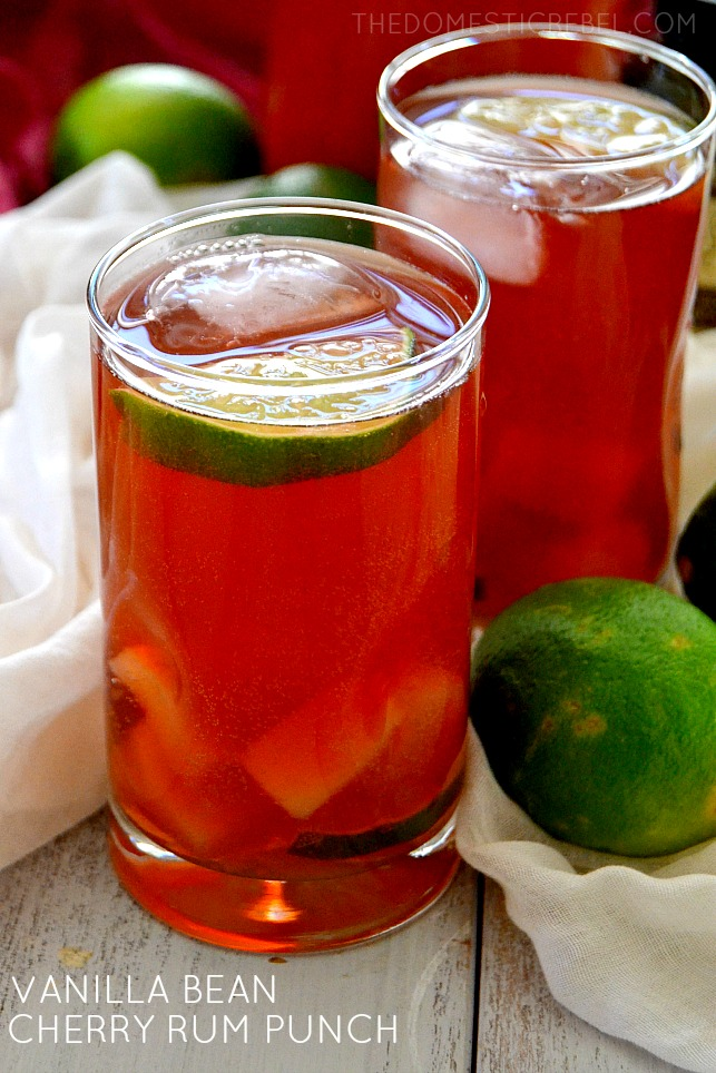 Vanilla Bean Cherry Rum Punch in glasses with limes
