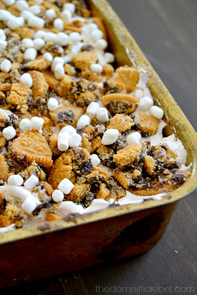 S'mores Lush Dessert in gold pan on dark wood