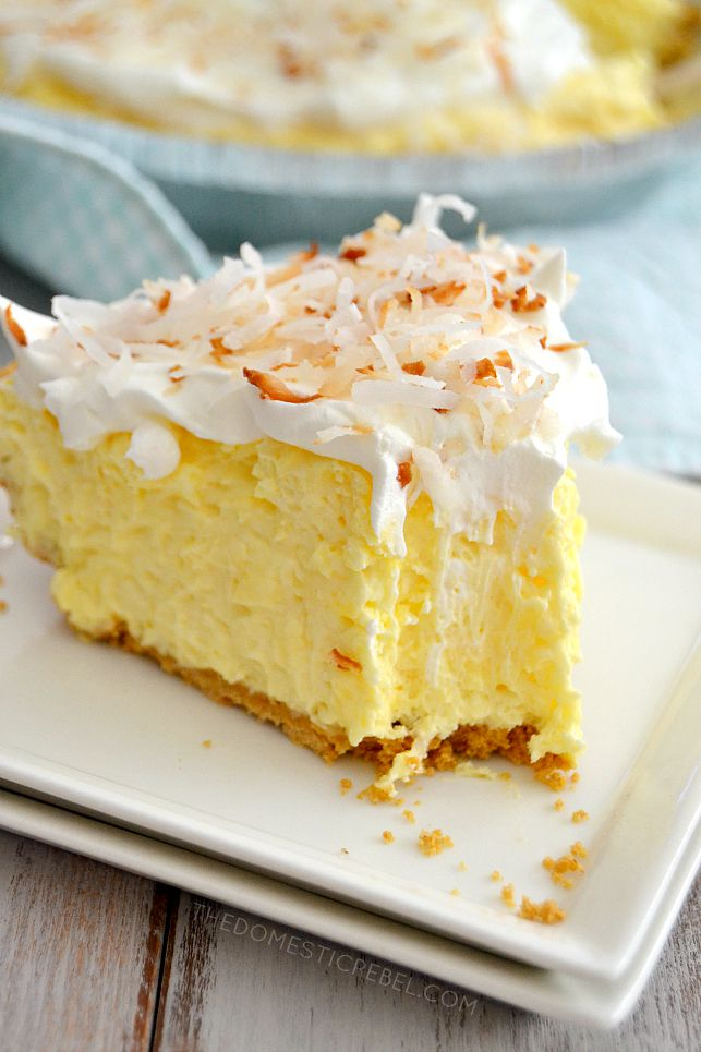Coconut Cream Pie on white square plates with bite missing