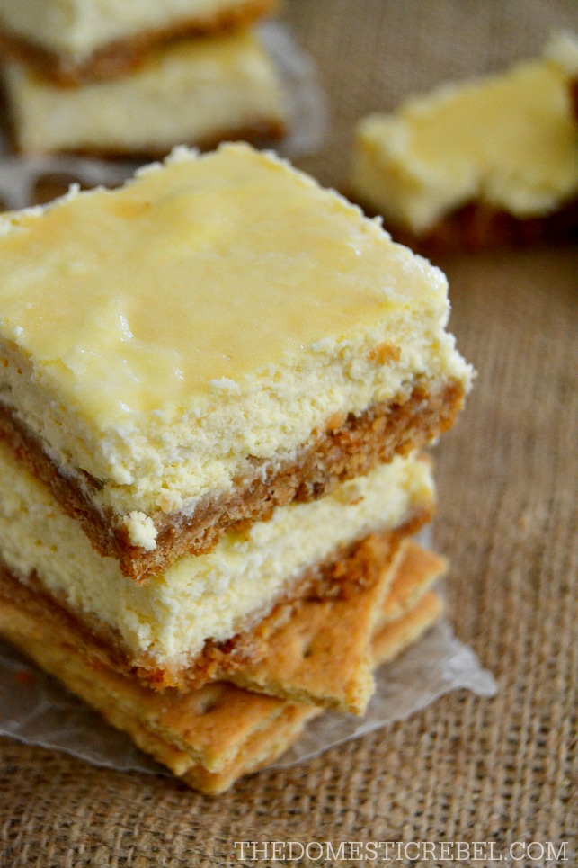 Cheesecake Bars stacked on graham crackers and burlap fabric