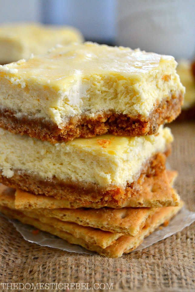Cheesecake Bars stacked on graham crackers with bite removed