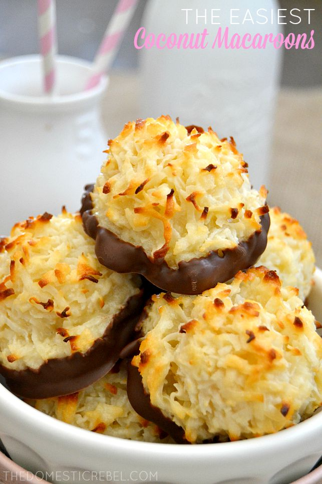 Coconut Macaroons stacked in white dish with milk bottles in background