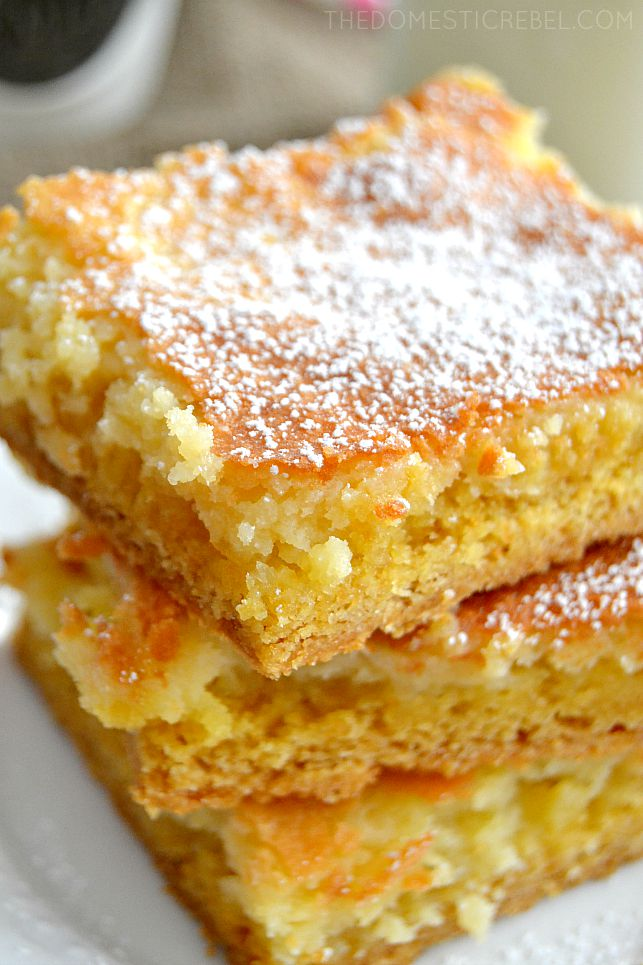 Gooey Butter Cake Bars stacked on white plate