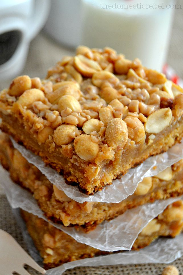 Peanut Brittle Bars stacked between parchment paper