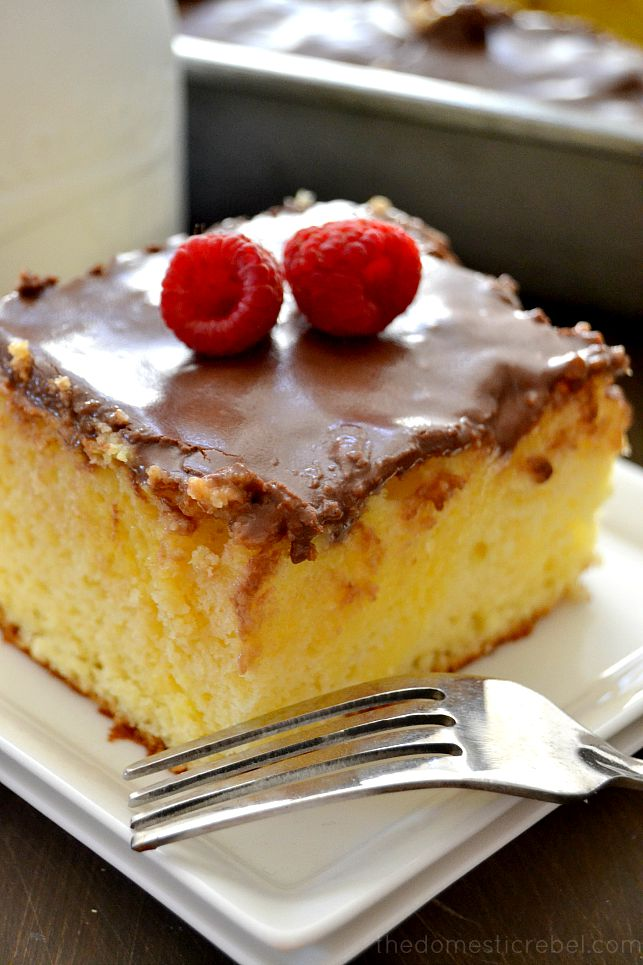 This Boston Cream Pie Poke Cake comes together in minutes and tastes AMAZING! It's easy, chocolaty, creamy and extra sweet!