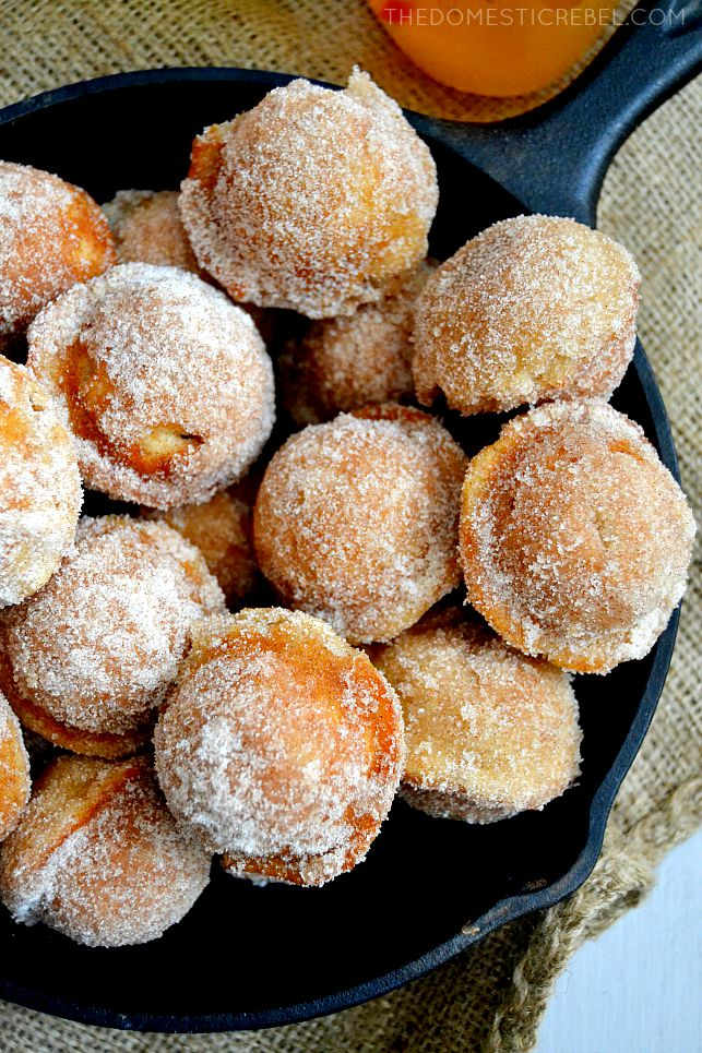 Apple Cider Donut Holes piled in a cast iron pan