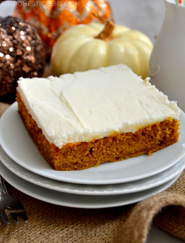 Pumpkin Spice Sheet Cake on a stack of white plates with pumpkins in background