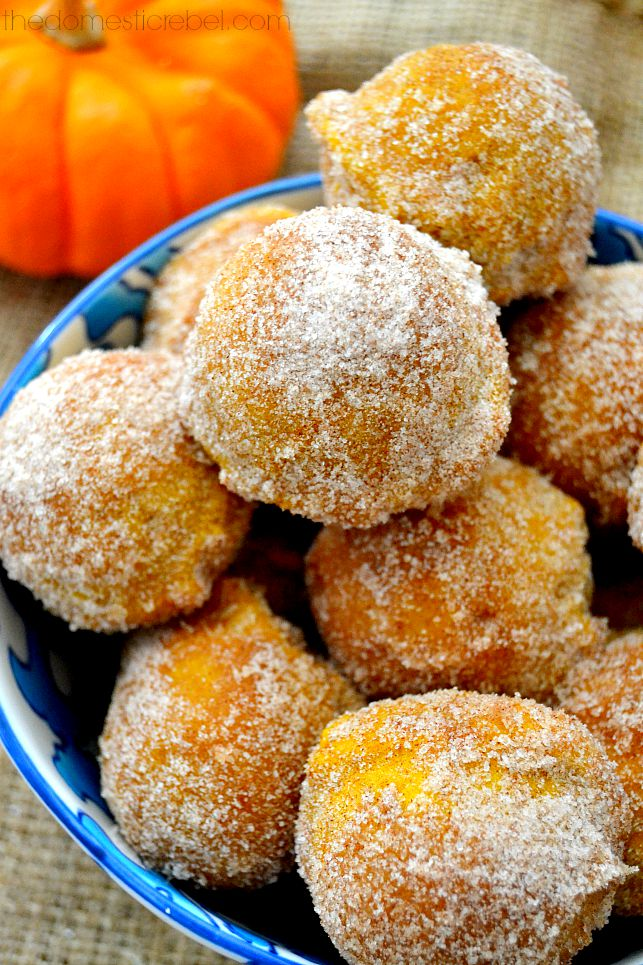 These Maple Pumpkin Donut Holes are so easy to whip up and even easier to eat! Perfectly spiced, scented with maple syrup and packed with pumpkin flavor, they'll soon become a new fall staple!