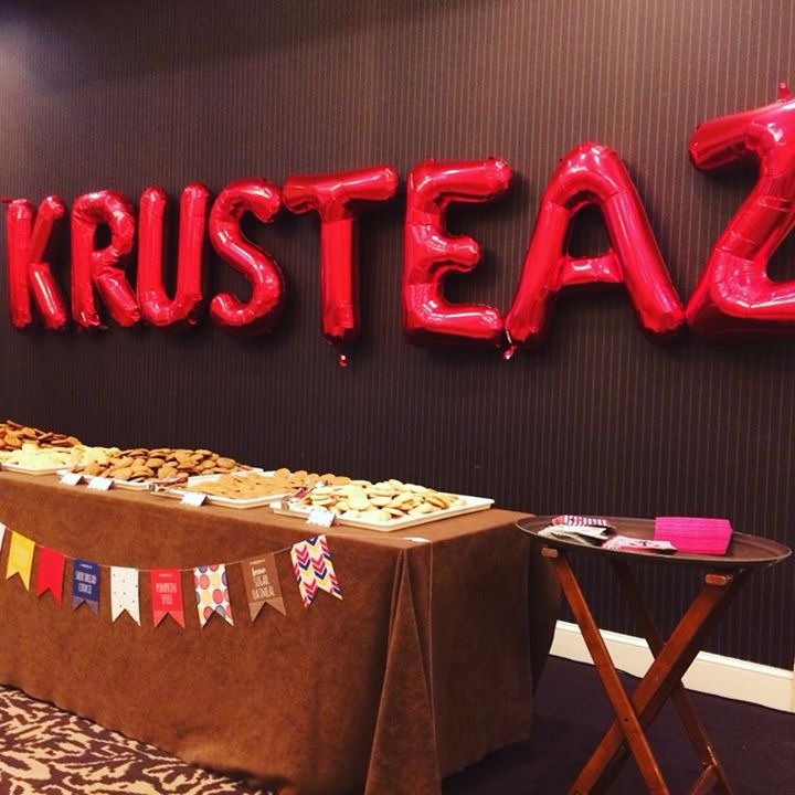 "photo of a Krusteaz booth with ""Krusteaz"" balloons"