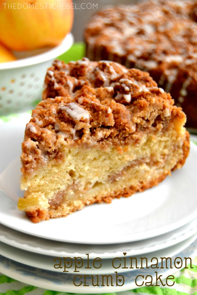 apple cinnamon crumb cake on stack of white plates and green background