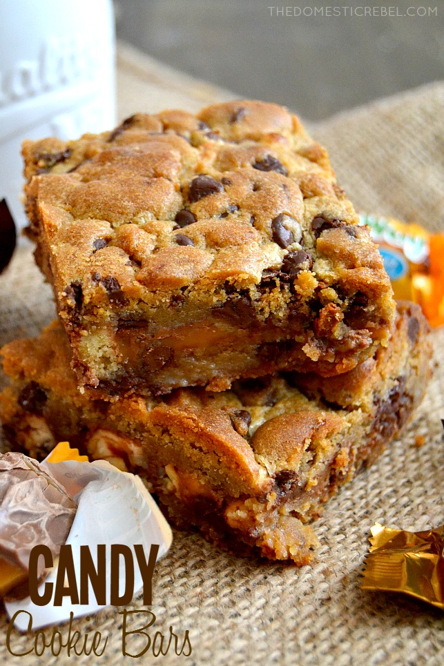 These Candy Cookie Bars couldn't be easier to whip up! Chewy chocolate chunk cookies are sandwiched between gooey chopped candy bars in these delightful, foolproof cookie bars!