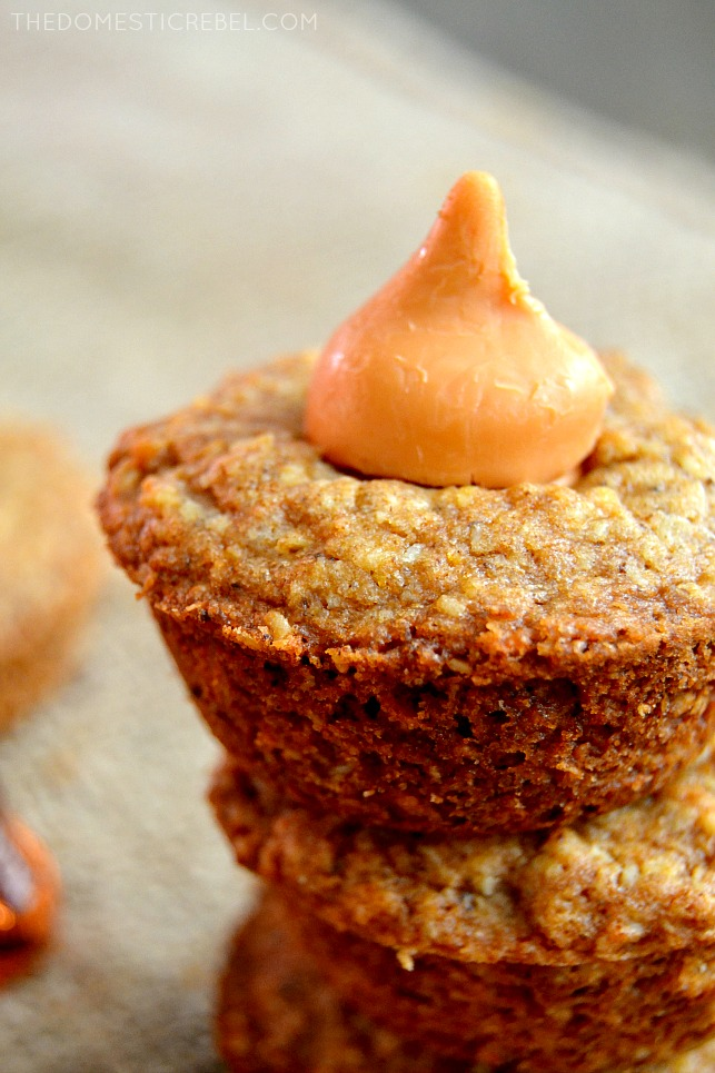pumpkin kiss cookie cups stacked on burlap fabric