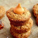 These Pumpkin Kiss Cookie Cups are so simple and foolproof! Simply bake up oatmeal cookies in muffin tins and pop in a Hershey's Pumpkin Spice Kiss for a delectable seasonal treat!