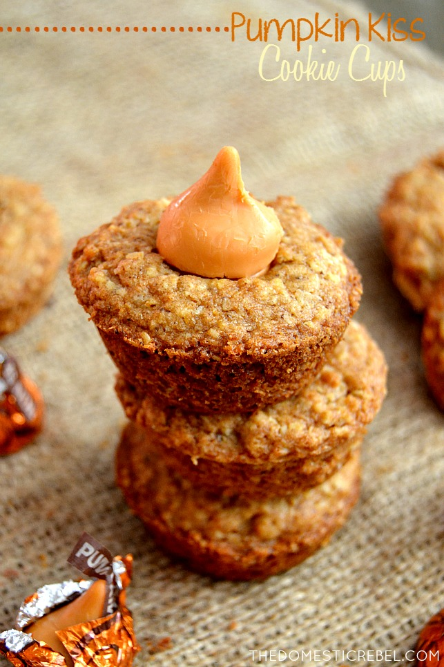 pumpkin kiss cookie cups stacked on burlap