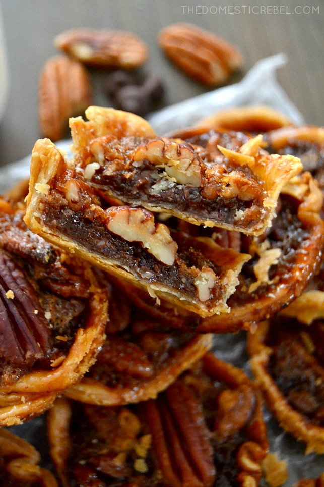 chocolate chip pecan pies cut open to show interior while stacked on wood