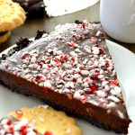 This Chocolate Peppermint Ganache Pie is rich, smooth, ultra decadent and SO EASY to make! Impress all your guests this holiday season with this simple, gorgeous pie!