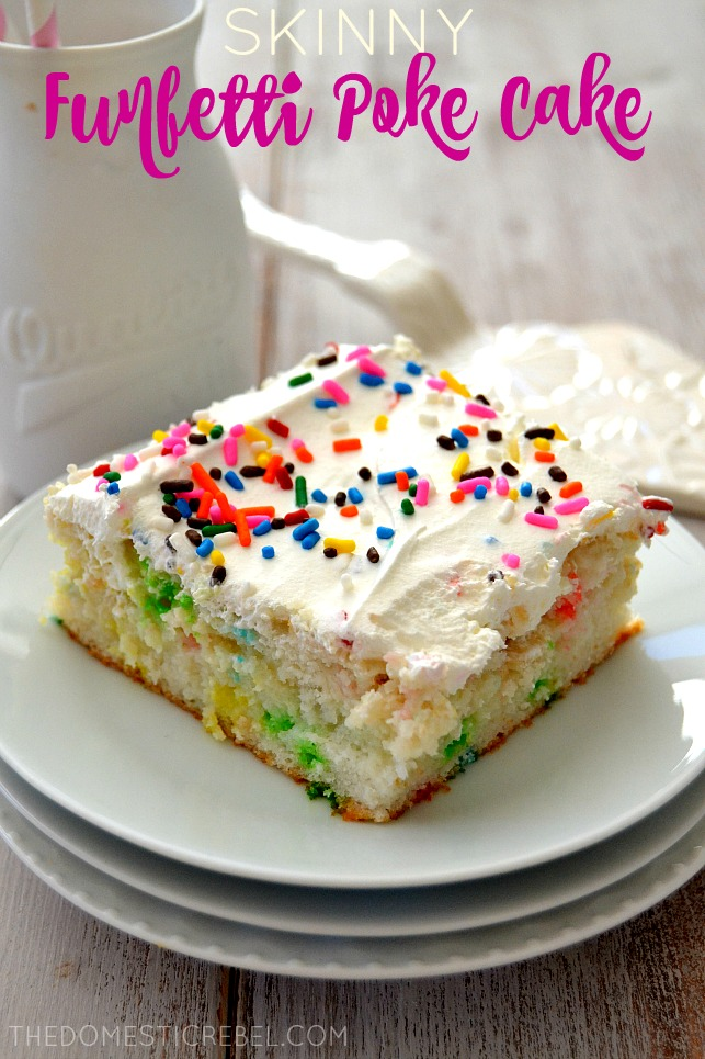 Skinny Funfetti Poke Cake on stacked white plates with white cake server behind it