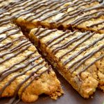 This XXL Monster Peanut Butter Cup Cookie is easy - thanks to a secret time-saving ingredient! Buttery, chewy and LOADED with peanut butter cups, it's perfect for pleasing a crowd!