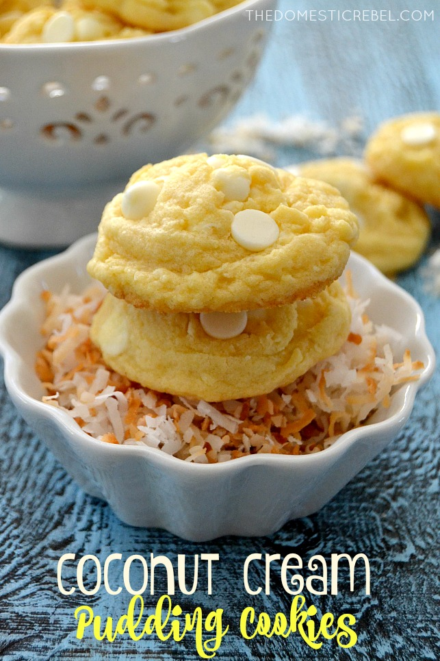 Coconut Cream Pudding Cookies stacked in a bowl of toasted coconut on blue background