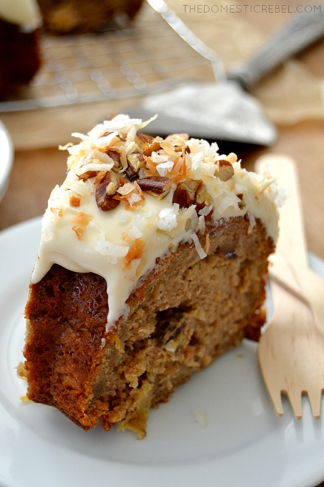 Closeup of Hummingbird Cake slice on white plate with wooden fork
