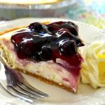 This Lemon Blueberry Cheesecake is outrageously delicious and SO simple to make! Juicy, sweet and tart, it's the perfect balance of flavors in one spectacular dessert!