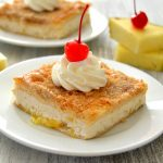 These Pineapple Upside Down Cheesecake Bars are such a fun spin on the classic cake! This EASY recipe takes minutes to prepare and features rich brown sugar, juicy pineapple, creamy cheesecake and a brown sugary crust that's positively irresistible!