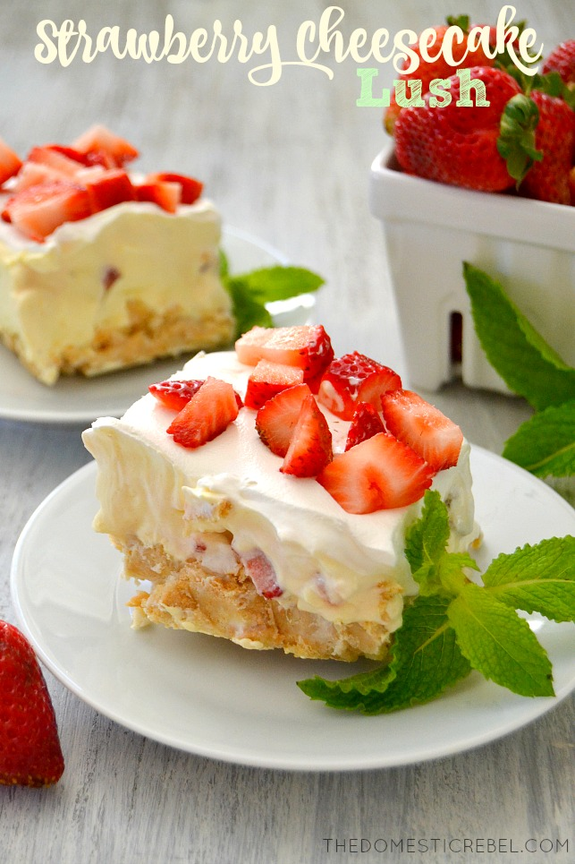 Strawberry Cheesecake Lush on white plates with fresh mint and fresh strawberries