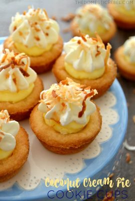 These EASY Coconut Cream Pie Cookie Cups are awesome! Bite-sized sugar cookie cups baked and filled with a fluffy, light coconut cream pie filling and topped with fresh whipped cream and toasted coconut. So easy and great for anytime entertaining!