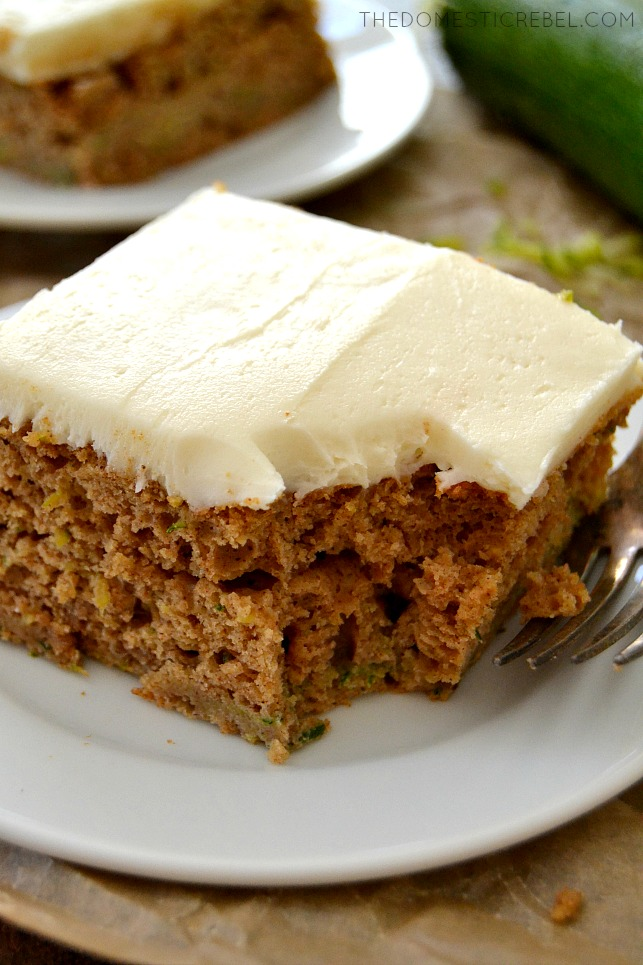 Closeup of Zucchini Cake on white plate with fork and bite missing