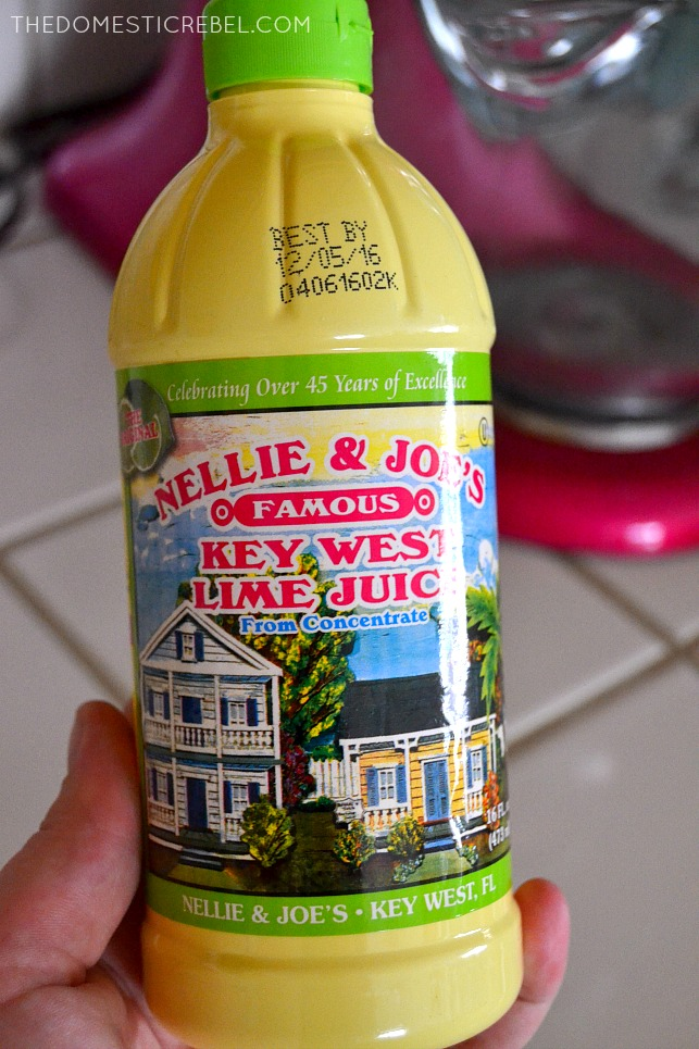 Photo of Key Lime juice in bottle with pink mixer in background